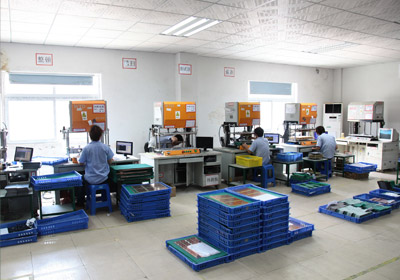 Mass production printed circuit boards are tested with e-test adapter machines